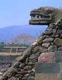 Image of the a serpent stone outside of The Temple Quetzalcoatl | Central Mexico |Courtesy of dreamstime