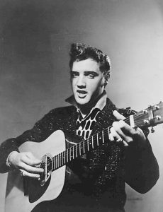 Elvis Presley on stage on January, 28, 1956. | Credit to CBS