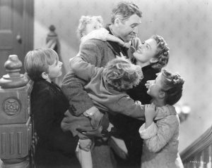 "George Bailey returns home to celebrate life with his family in ""It's a Wonderful Life"" 