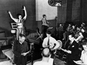 "Welles and his cast rehearse for the live radio production of ""War of the Worlds"" 