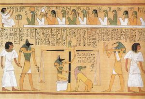 this is a Funerary text depicting Anubis as he cast judgment upon the dead.