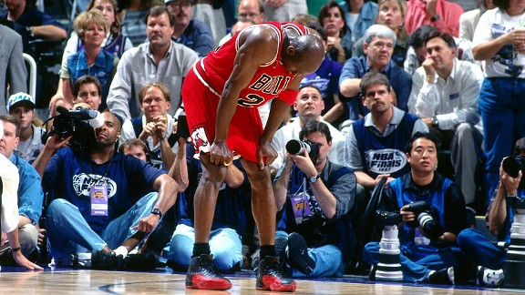 04988e4676414b A fatigue Michael Jordan on his knees during game 5 of the 1997 NBA Finals.