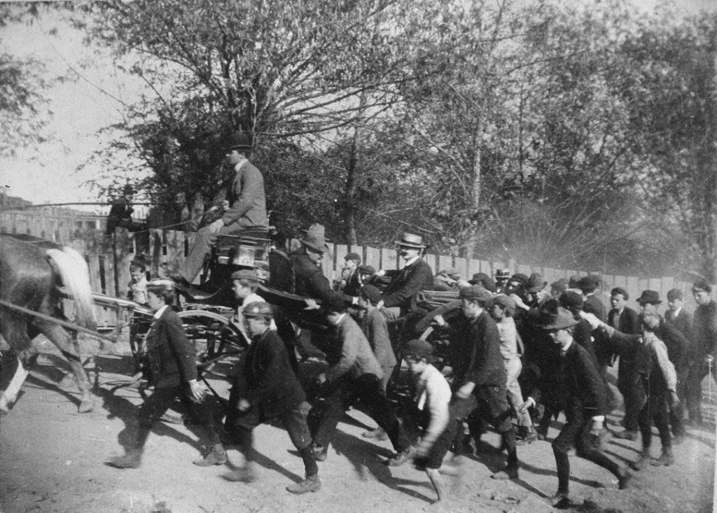John Mitchell, President of the UMWA, arriving in Shenandoah surrounded by a crowd of breaker boys. 1902. | Courtesy of Wikipedia